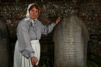 The ghost of Sarah Louise Hopson stands next to the grave of her daughter.: Click to enlarge